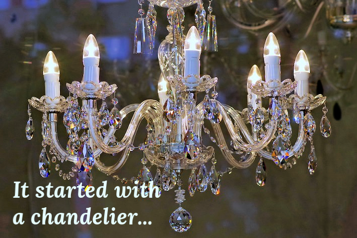 Sparkling chandelier with center crystal.
