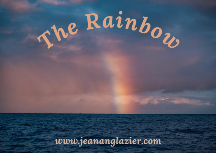 End of a rainbow meeting the ocean